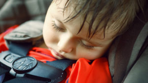 Closeup portrait of a cute adorable little boy toddler tired and sleeping belted in car seat on his trip, safety protection concept; Shutterstock ID 283664960; PO: today-david-150710